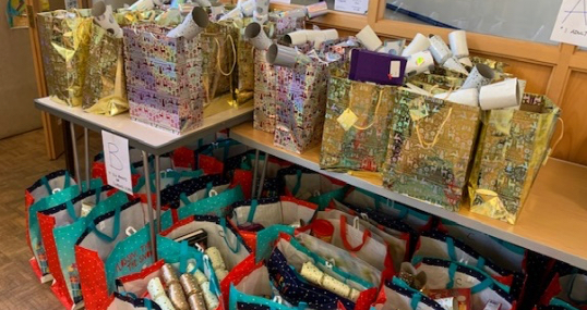 Shoe boxes ready to go, donations in the Hall and Xmas gift bags.